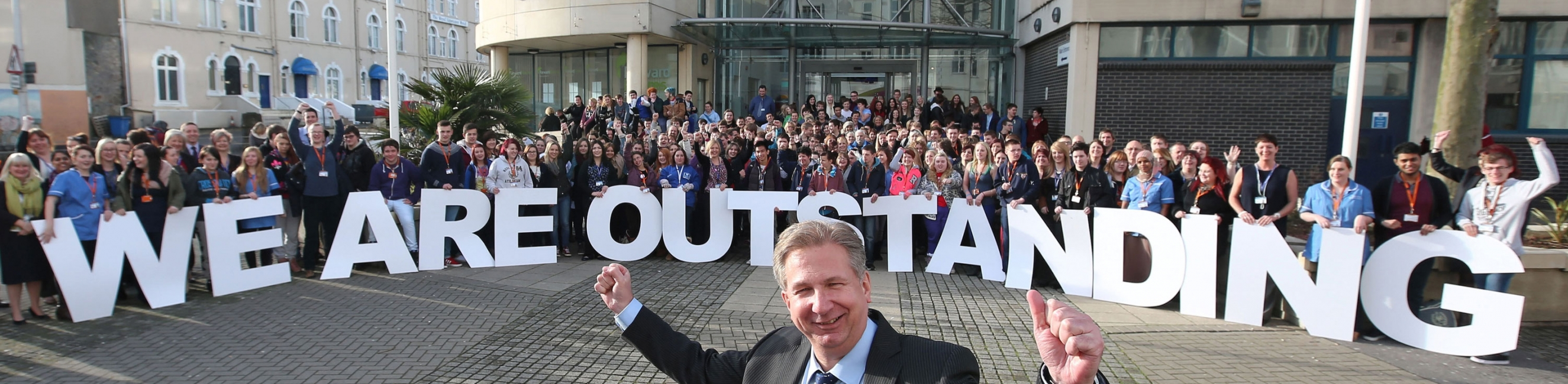 Weston College Principal Dr Paul Phillips celebrates the Ofsted Outstanding result with staff and students